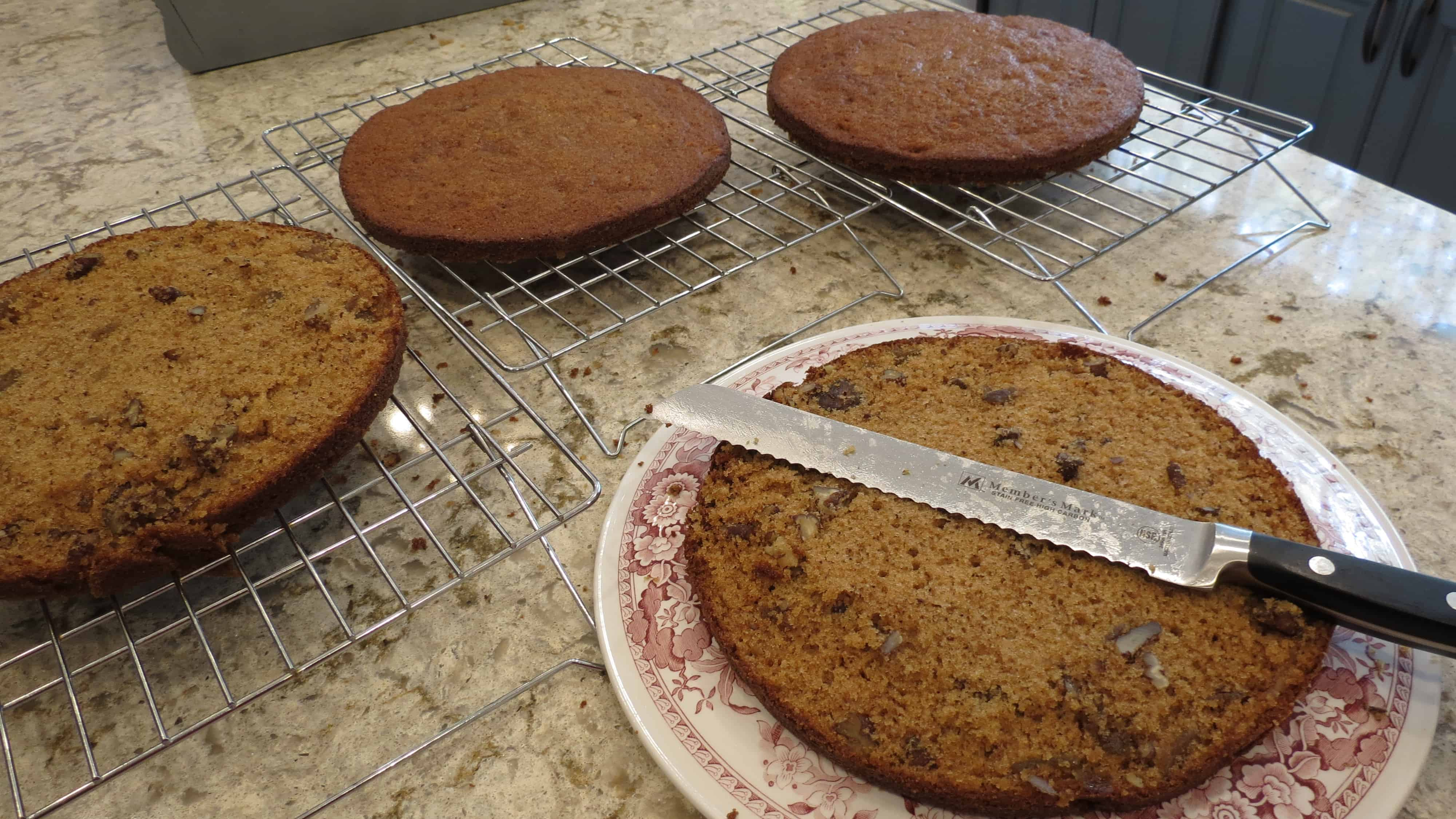 Round fig cake layers sliced into halves.