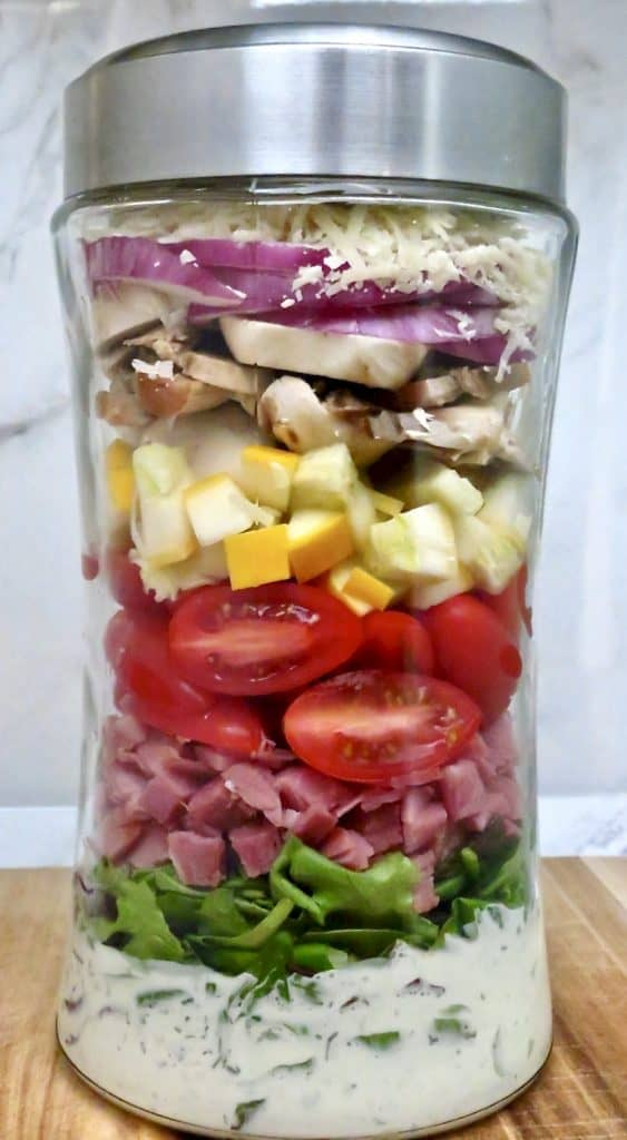 Salad stacked in a jar with homemade buttermilk ranch dressing