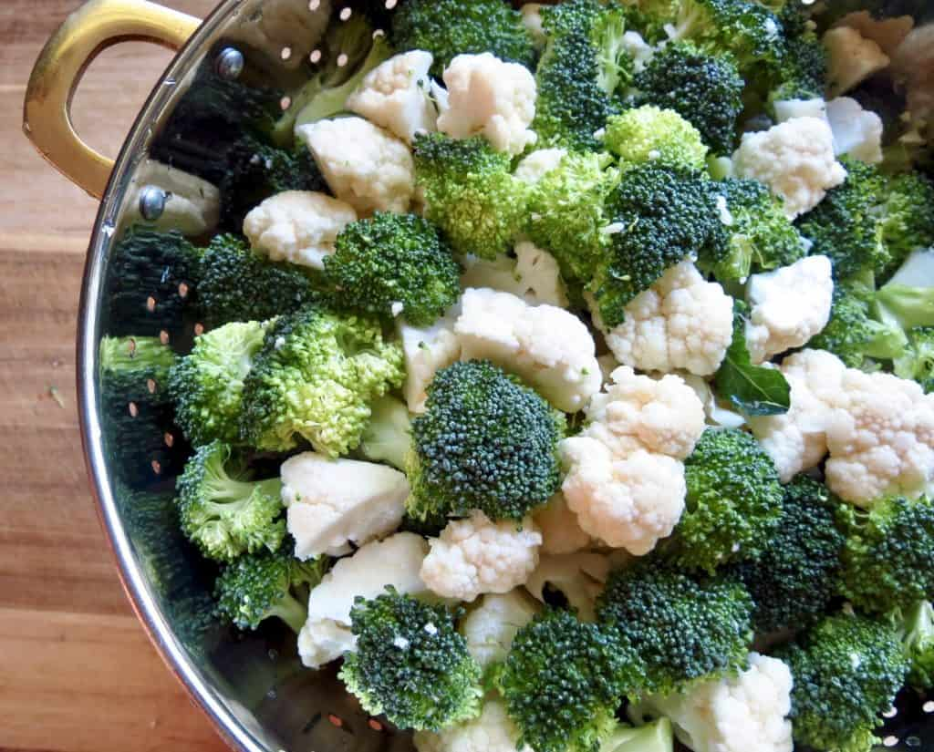 broccoli and cauliflower in a strainer