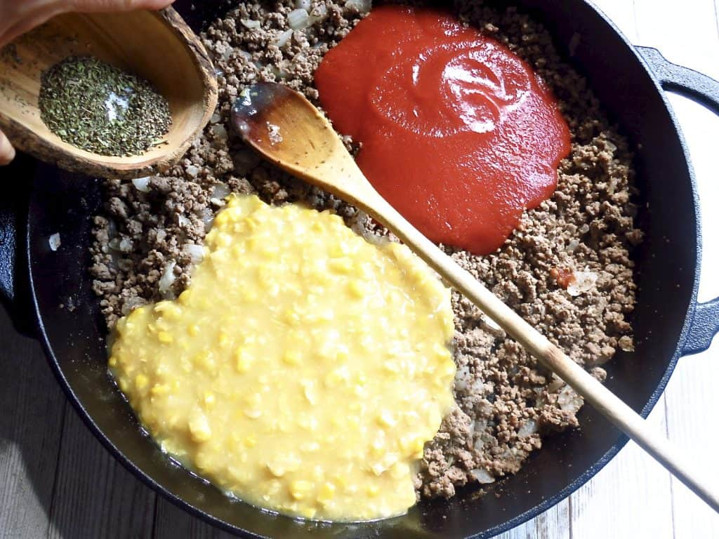 Ingredients of ground beef, cheese, and cream corn for More Casserole, One-Pot Meal .