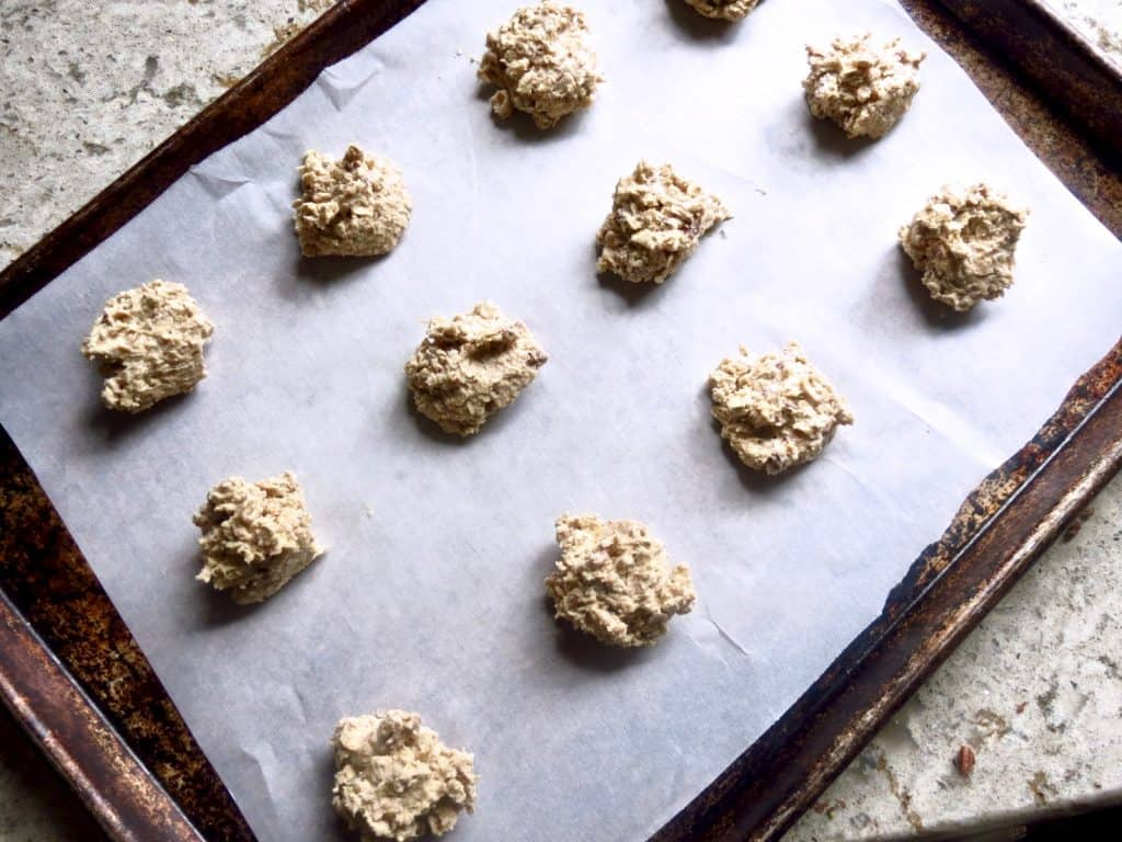 Lunchroom Lady Oatmeal Cookies unbaked on a cookie sheet lined with parchment paper.