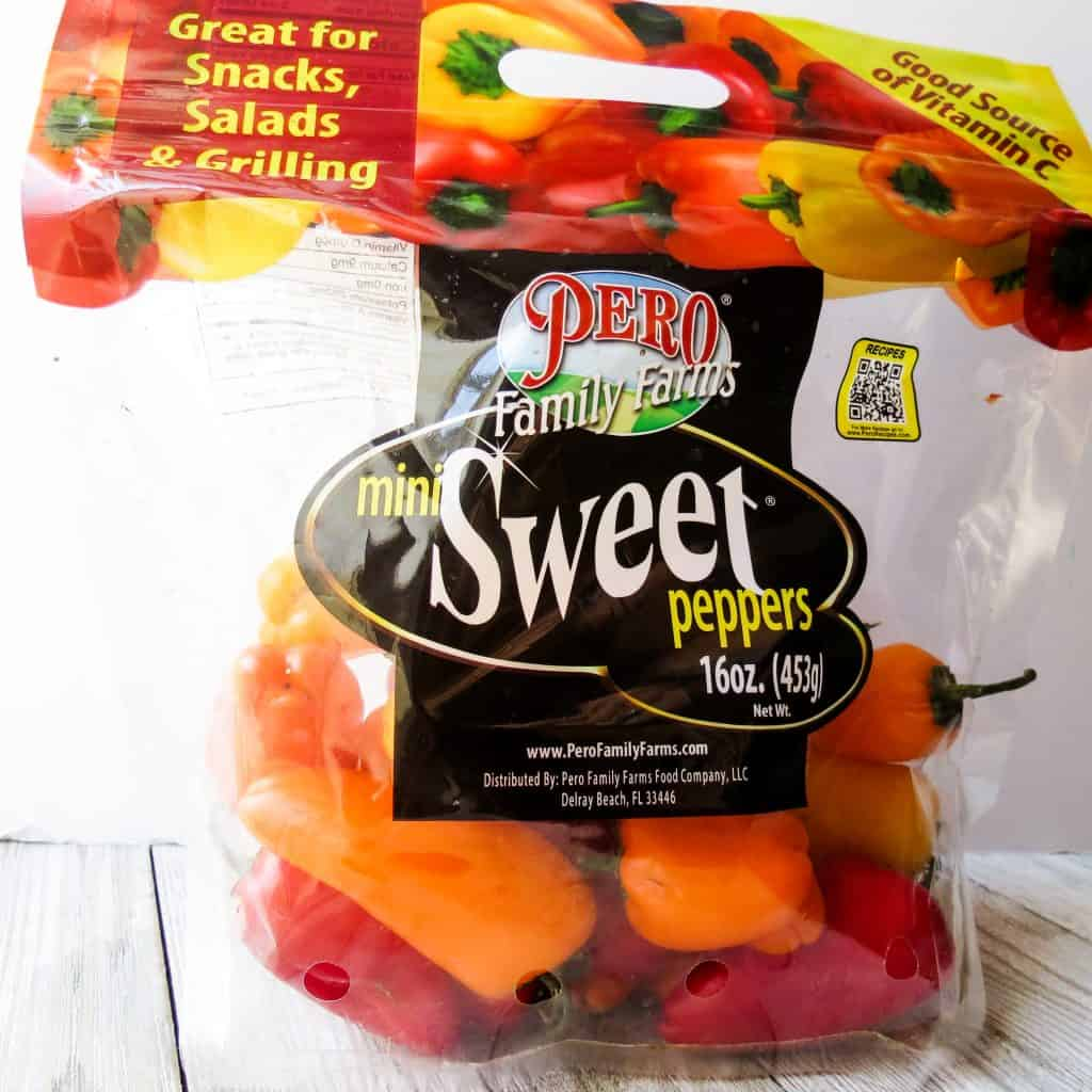 A bag of sweet red, orange, and yellow mini peppers for Spinach Medley, A Healthy Spinach Side Dish.